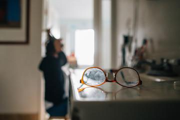 Eye glasses on the bathroom counter