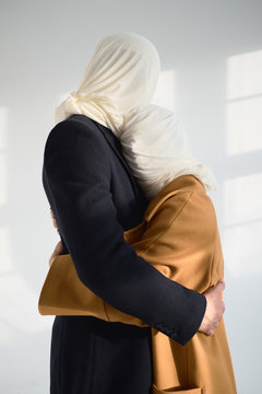 Loving couple with covered faces