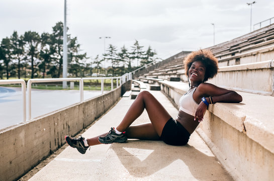Portrait of athlete woman relaxing in stadium