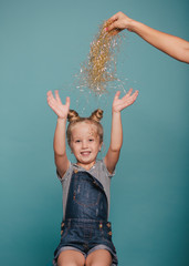 Cute young girl having fun with party accessories