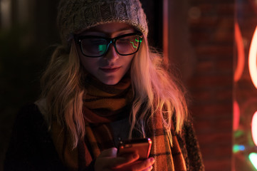 Girl with phone on cold street