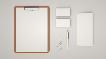 Clipboard, business cards, leaflet, paper clips and pen