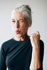 Portrait of woman making a face
