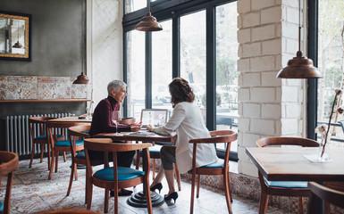 Women Talking at Cafe
