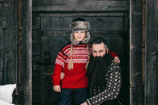 Bearded Hipster Father With His Daughter in Traditional Norwegia