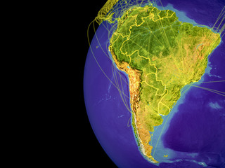 South America from space on planet Earth with lines representing global communication, travel, connections.