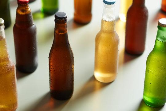 Different types of beer in bottles.