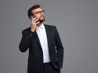 Young businessman speaking on phone