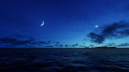 Night sky with moon, ocean sky and island