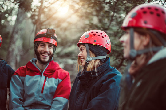 Friends laugh and enjoy the outdoors during a zip line course in upstate New York