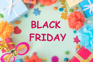 Black Friday banner with bright text on frame with multicolored gift boxes and decor on pastel background.  Black Friday sale