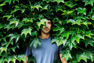 man hiding on the ivy plant