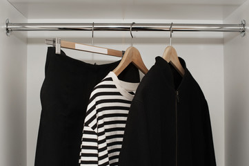 Clothes on a rail in black and white tones