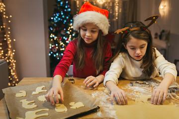 Girls making Christmas cookies
