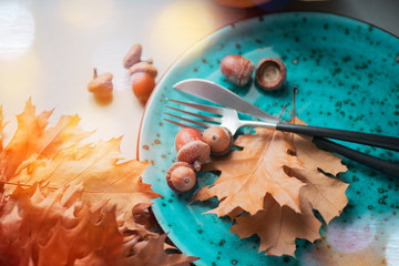 Thanksgiving. Holiday dinner table served, decorated with bright autumn leaves. Top view
