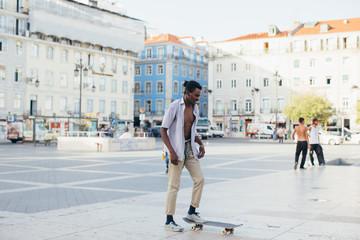 Young men skating at square, Lisbon, Portugal