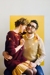 Loving couple wrapped with garland