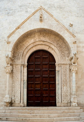 Romanesque architecture cathedral portal church. Bisceglie. Apulia. Italy