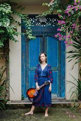 Young girl holding a ukulele