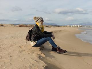 Pretty woman sitting on shore