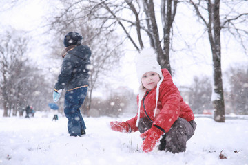 Kids walk in the park first snow
