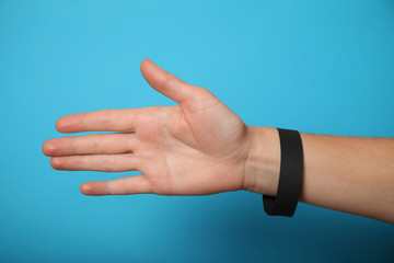 Concert black paper bracelet mockup, event wristband. Arm activity accessory, adhesive, cheap.