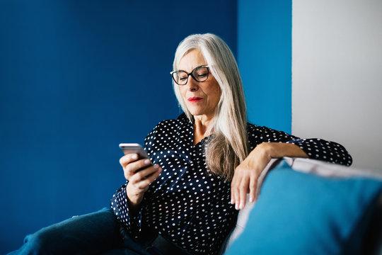 Senior businesswoman working at modern office.