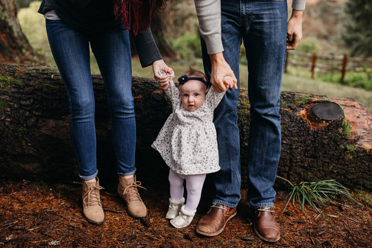 Couple Helping Baby Stand