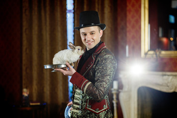 magician shows rabbit