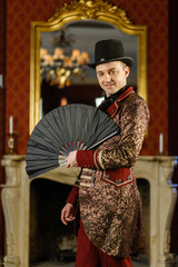 stylish magician shows focus. magic show