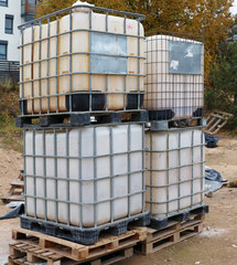 Large plastic steel reinforced containers used for storing water on construction sites.