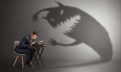 Little hard worker afraid of scary monster shadow
