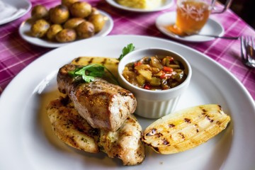 Pork and chicken meat with vegetable, potato.