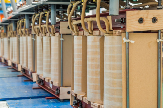 Internal active parts (core and coils) of transformer in production