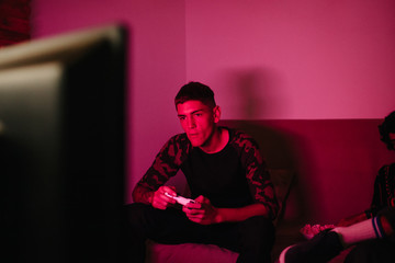Young man playing??_in dark room