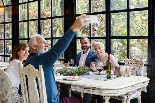 Friends Taking Selfie at Restaurant