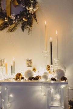 Christmas decorations: candles, lights, Christmas balls and a wreath put i together in a set