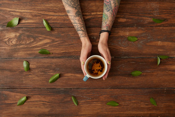 Female hands with hot tea