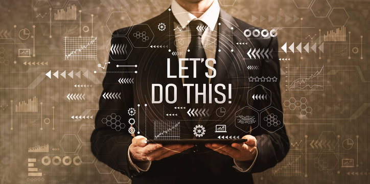Let's do this with businessman holding a tablet computer on a dark vintage background
