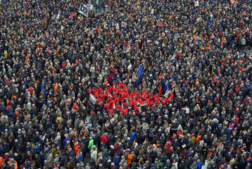 People take part in a demonstration to support the high-speed train line TAV in Turin