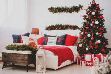 Christmas decorations in the bedroom or studio with bed and pillows