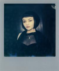 Polaroid silver frame scan of a cute gothic woman