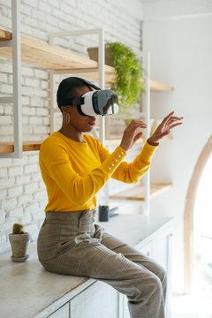 Woman wearing virtual reality headset at office.