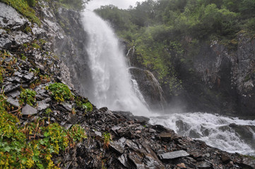 Waterfall scenes in mountains, national park Dombai, Caucasus, Russia, Europe