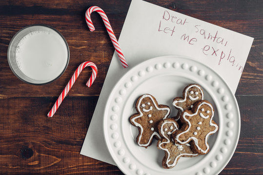 Gingerbread man cookies, candy canes, and a message for Santa