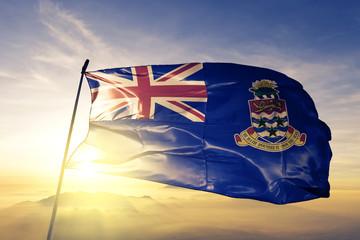 Cayman Islands Caymanian flag textile cloth fabric waving on the top sunrise mist fog
