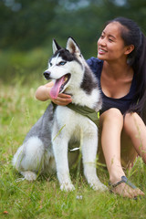 young woman with her dog outdoor