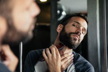 Man Shaving His Beard at Home