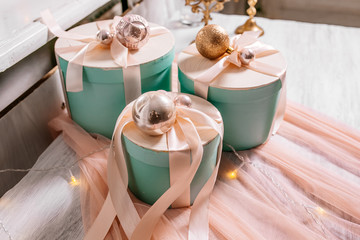 Christmas holiday composition a group of gifts on table on the background of garlands and fireplace. New year 2019. Place for text.