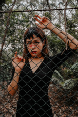 Asian with halloween makeup in forest